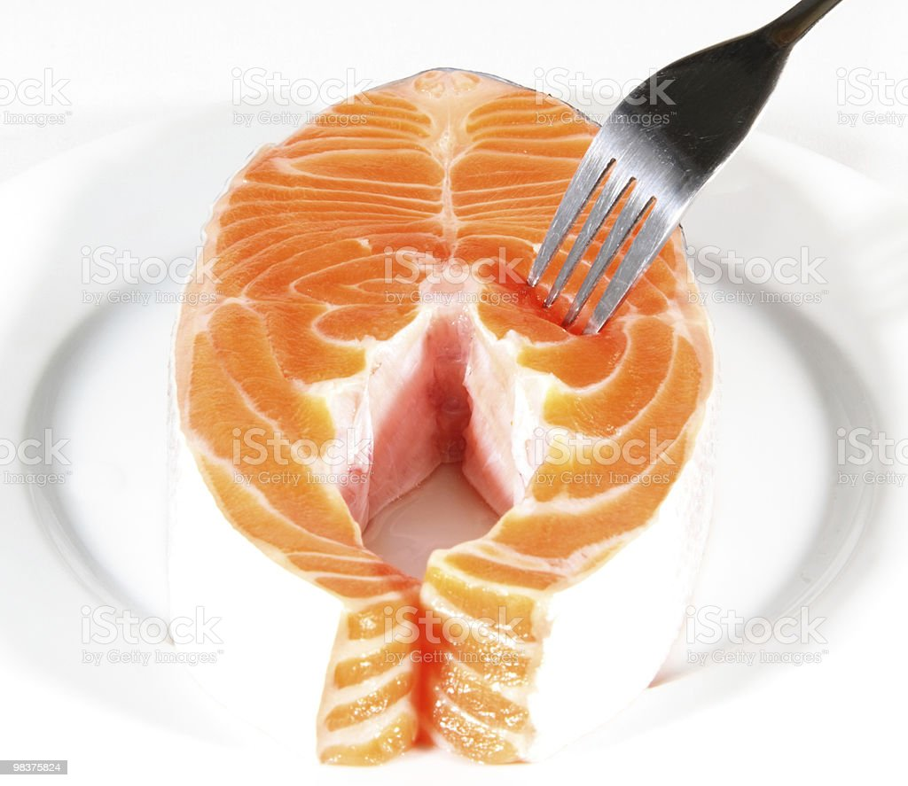 Salmon Slices pricked with a fork royalty-free stock photo