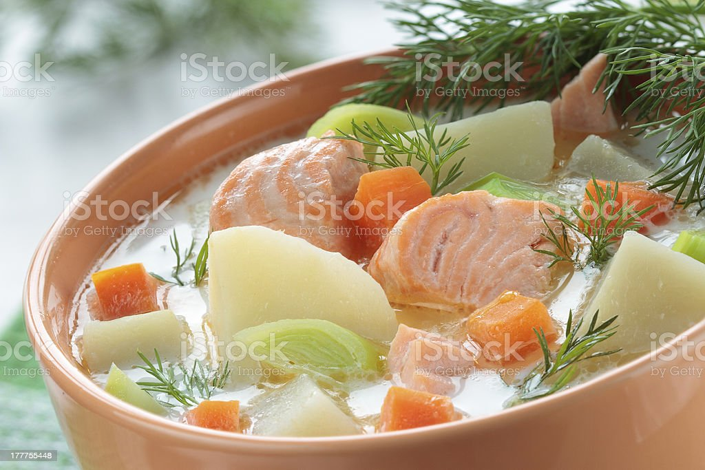Salmon soup with cream,  carrots royalty-free stock photo