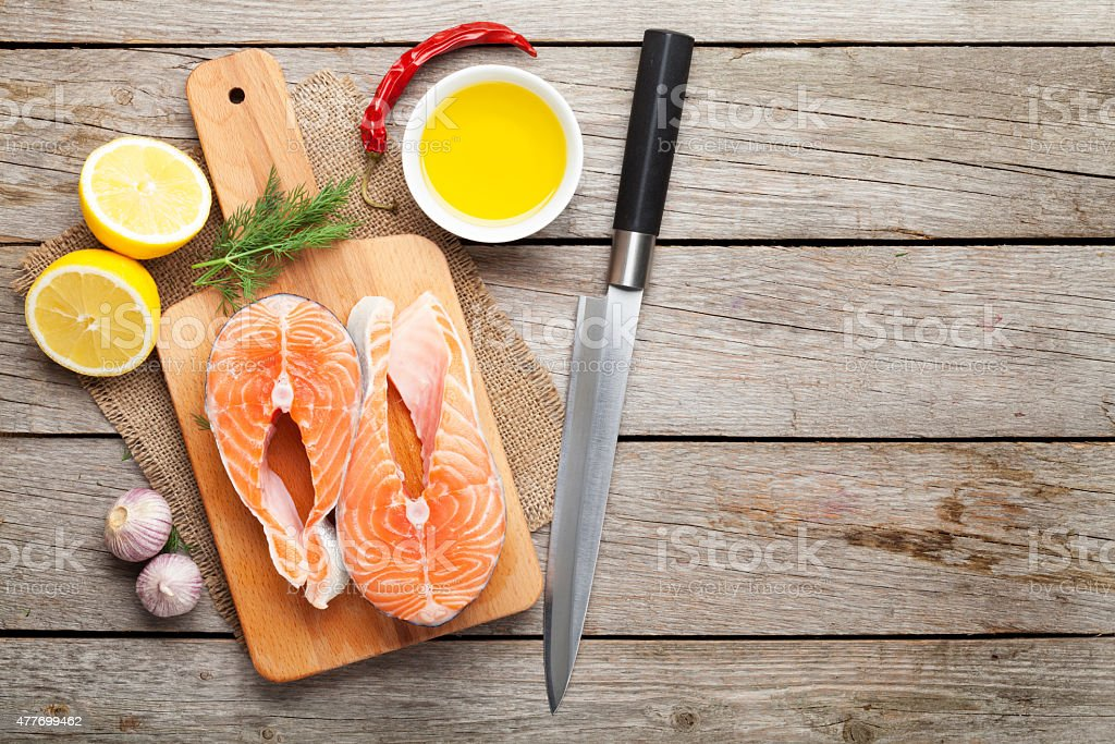 Salmon, spices and condiments stock photo
