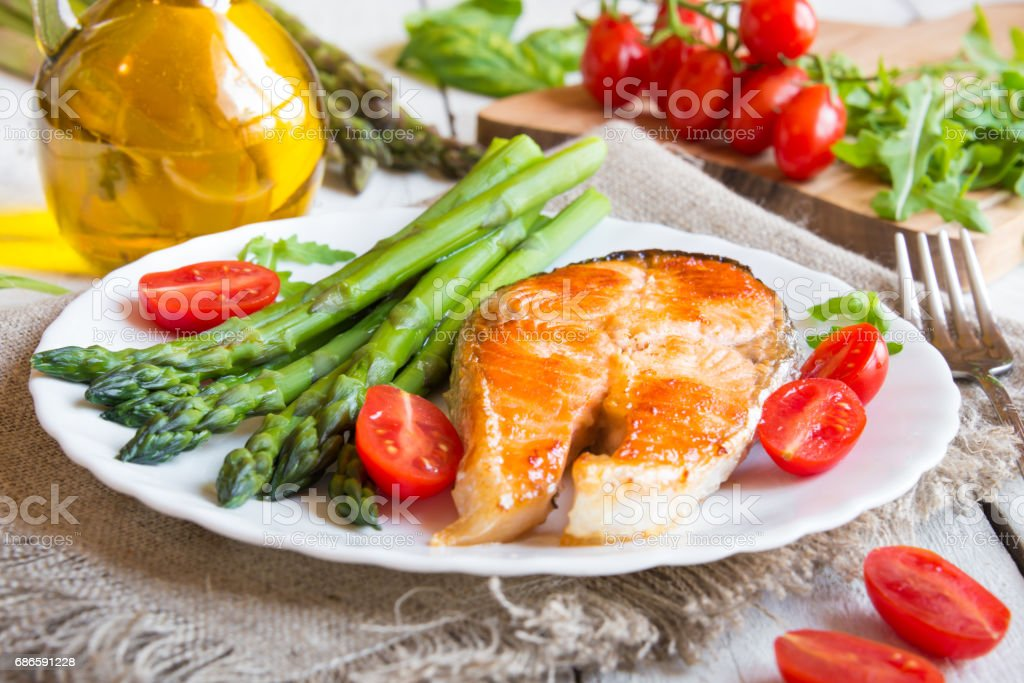 Salmon stake with asparagus royalty-free stock photo