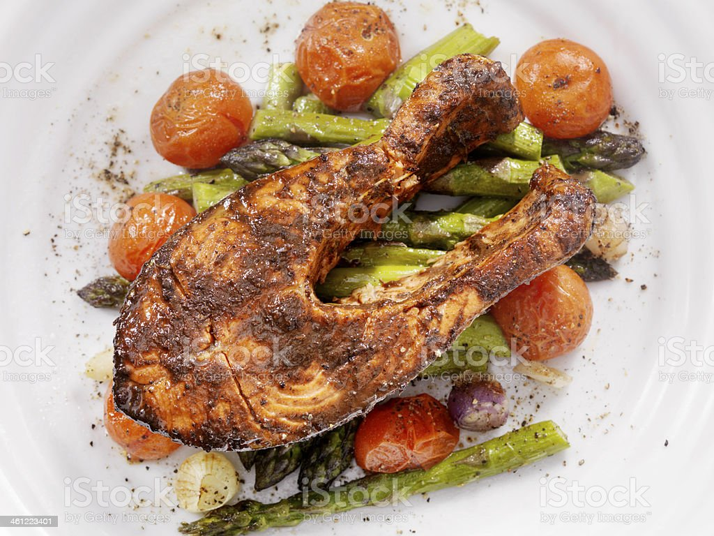 Salmon Steak on Roasted Vegetables stock photo
