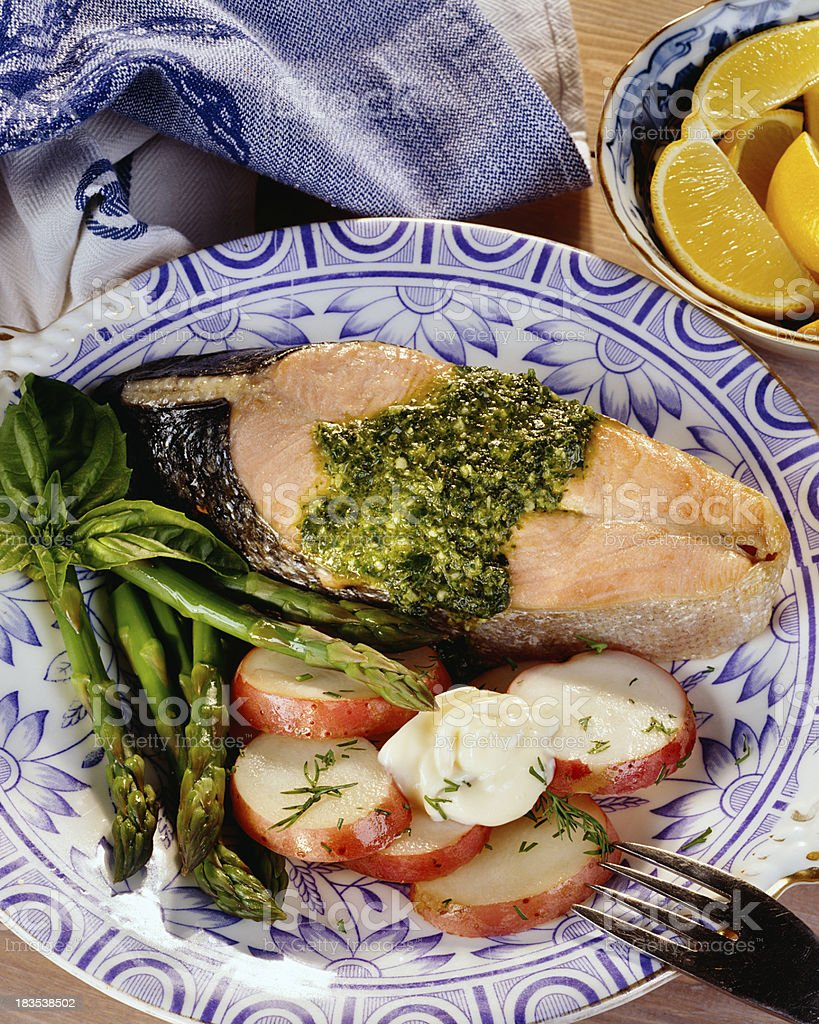 Salmon steak with asparagus and potatoes royalty-free stock photo