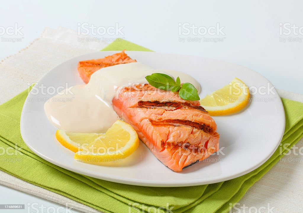 Salmon steak with lemon royalty-free stock photo