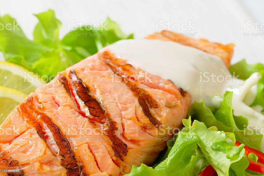Salmon steak with salad royalty-free stock photo