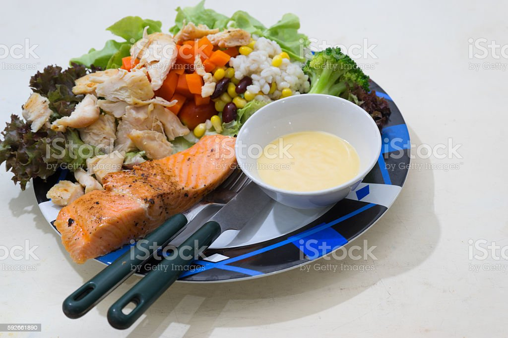 Salmon Steak with Vegetables and Salad stock photo