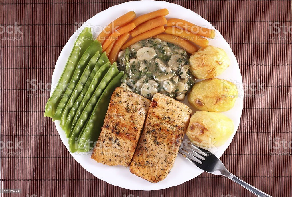 Salmon Steak with Vegetables royalty-free stock photo