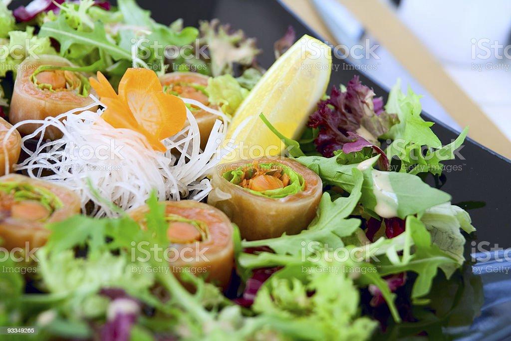 Salmon sushi with salad royalty-free stock photo