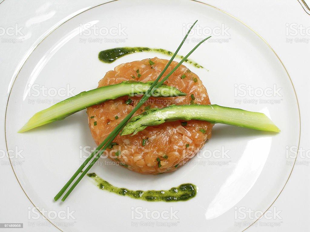Salmon tartar with asparagus royalty-free stock photo