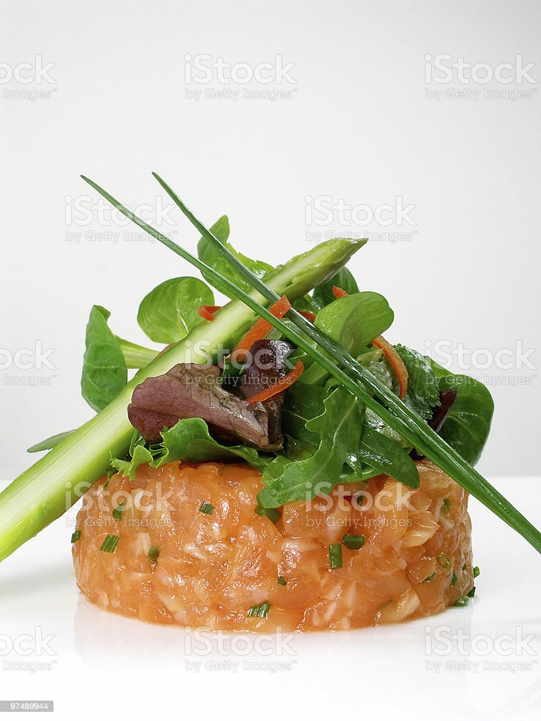 Salmon tartar with salad and green asparagus royalty-free stock photo