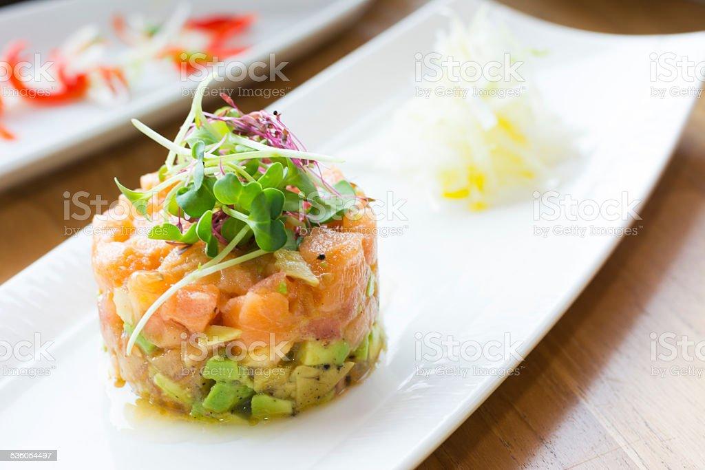 Salmon Tartare stack with Avocado, Olives & Tarragon stock photo
