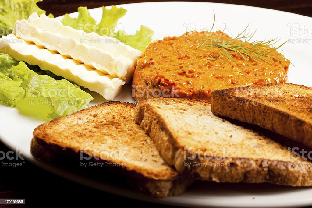 Salmon tartare whit toasted bread butter and letuce. royalty-free stock photo