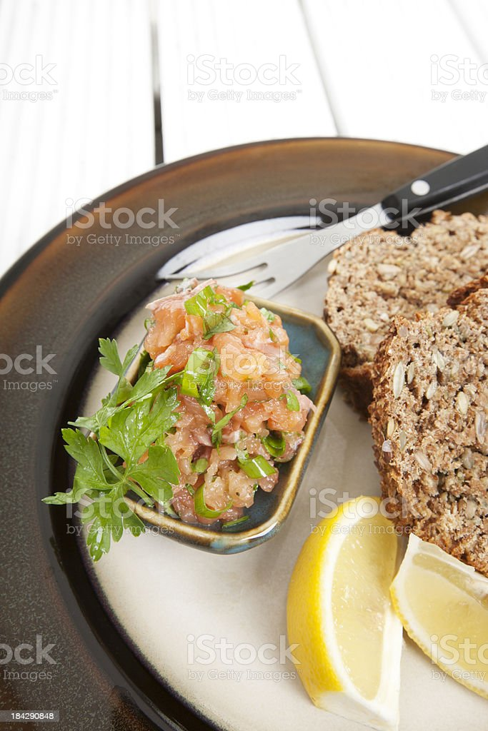 Salmon tartare with brown bread royalty-free stock photo