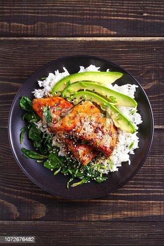 istock Salmon teriyaki rice bowl with spinach and avocado 1072676482