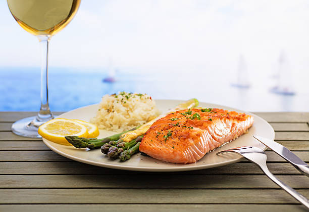 Salmon with asparagus and rice stock photo