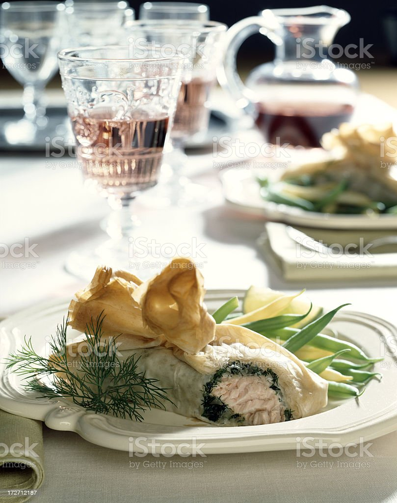 Salmon with dill in puff pastry royalty-free stock photo