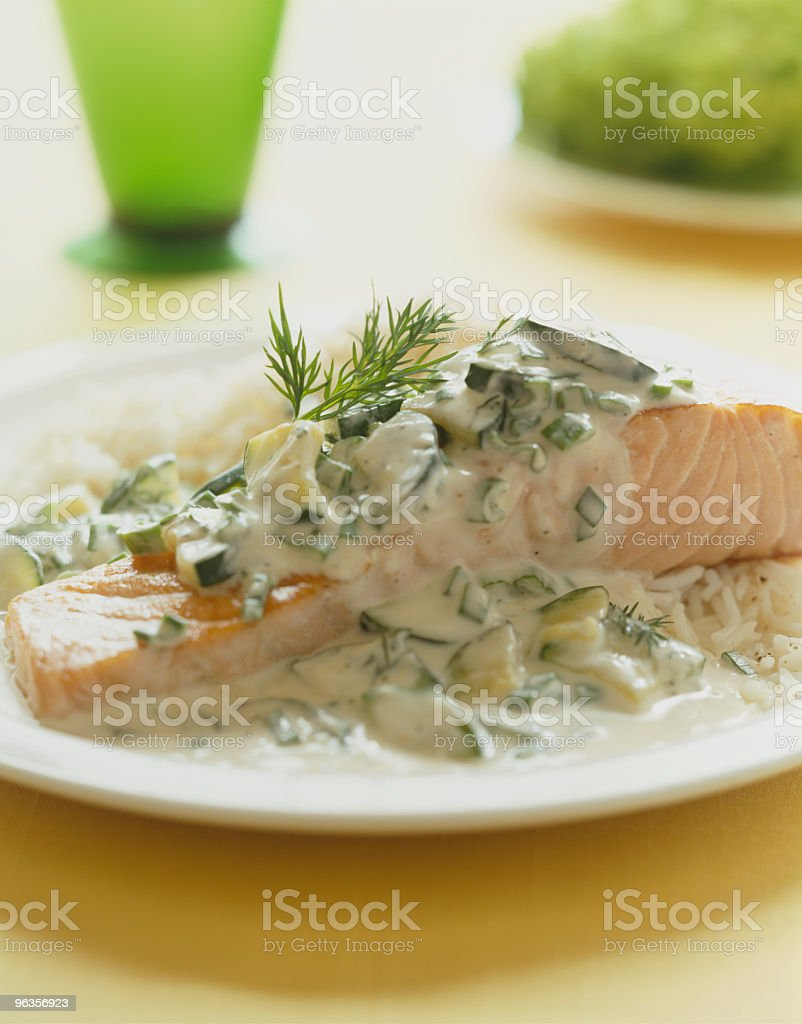 Salmon with dill sauce stock photo