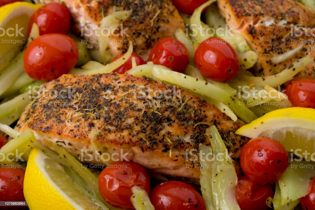 Pan-fried salmon fillets with fennel and cherry tomatoes
