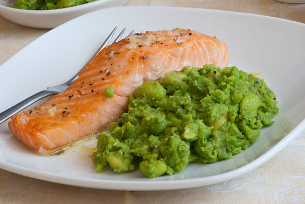 Salmon with mushy peas stock photo
