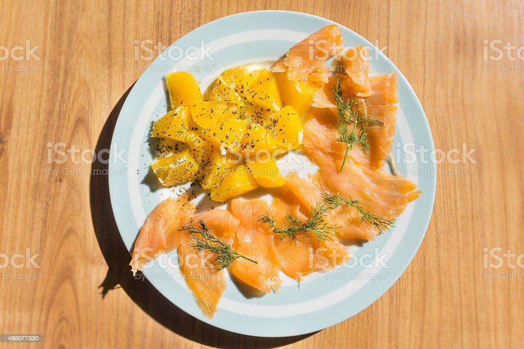 Salmon with orange salad stock photo