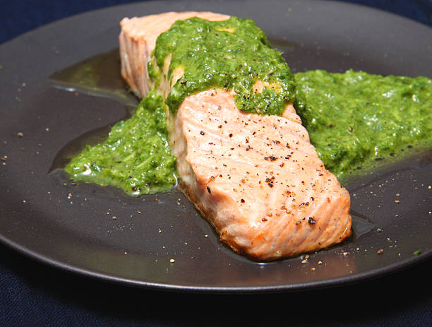 Salmon with salsa verde stock photo