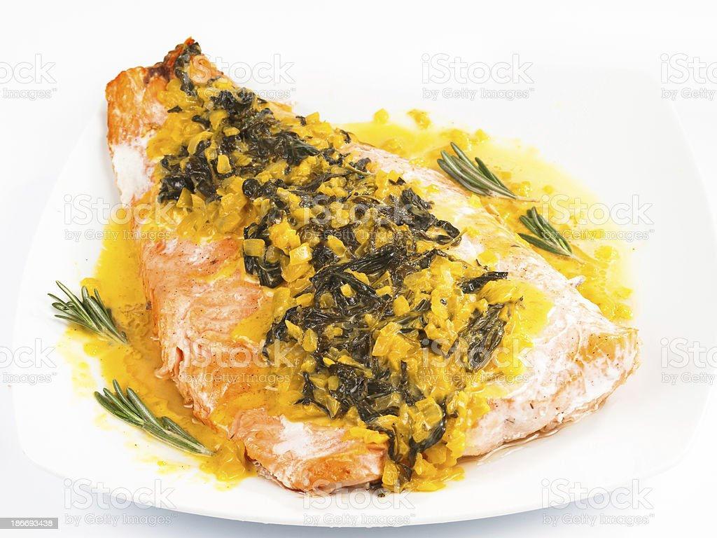 Salmon with sauce of saffron, onion and rosemary royalty-free stock photo