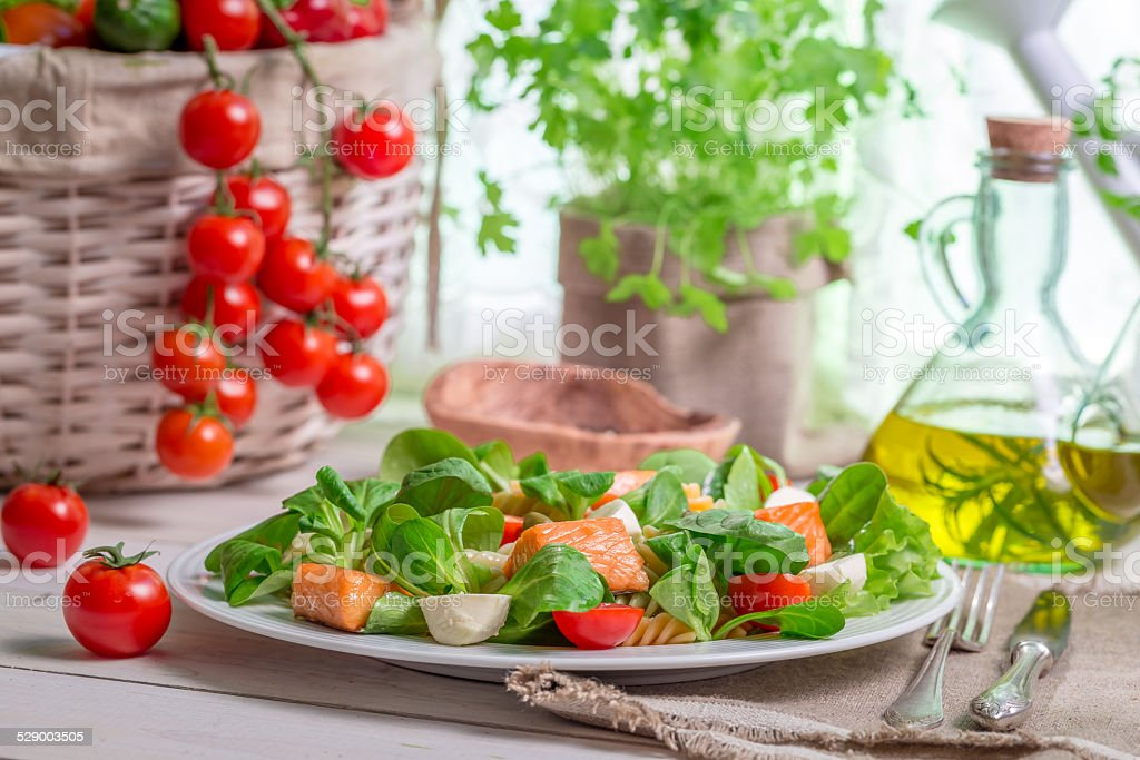 Salmon with vegetables and lettuce stock photo