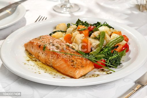salmon with vegetables on the plate