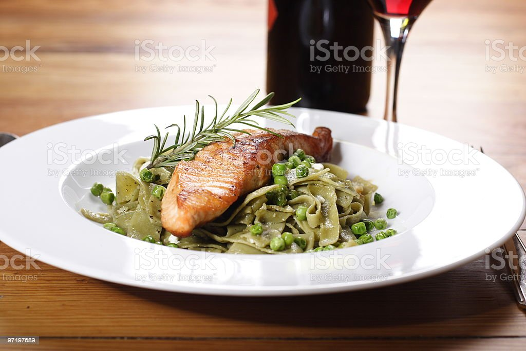 Salmon with wild garlic pasta and peas royalty-free stock photo