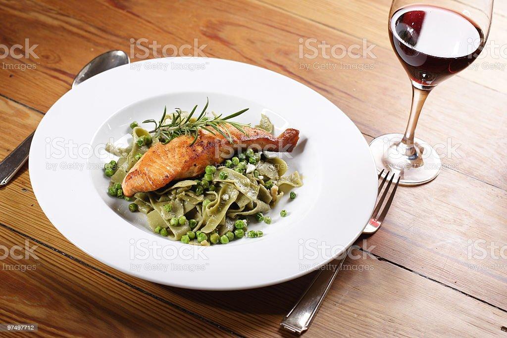 Salmon with wild garlic pasta royalty-free stock photo