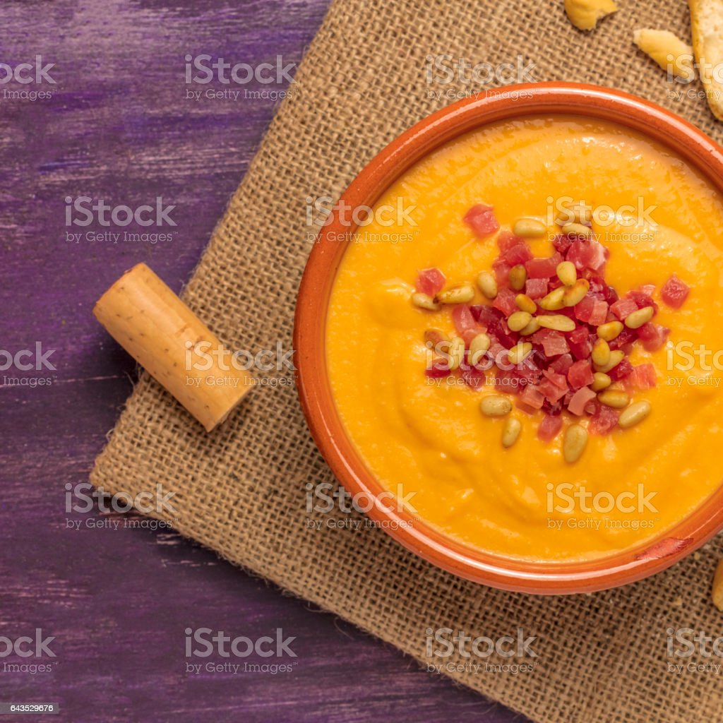 Salmorejo, traditional Spanish soup, with bread sticks and cork stock photo