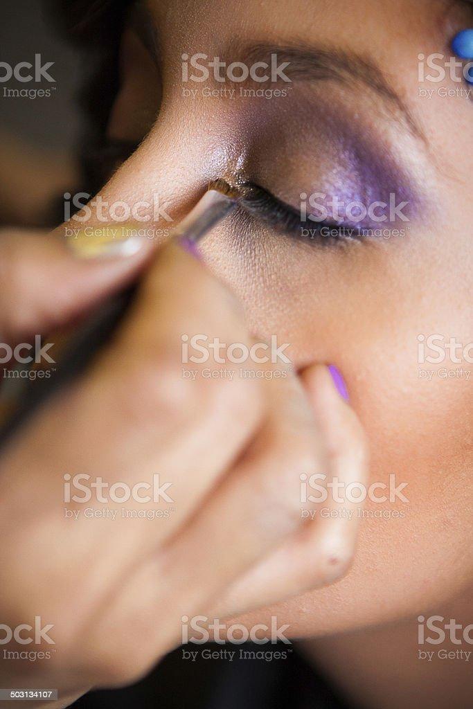 Salon Beautician Applies Makeup to a Customer stock photo