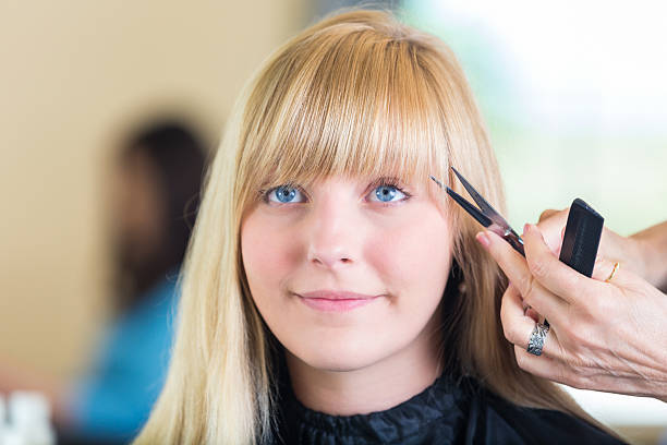 salon client having bangs trimmed by professional hairstylist pictures images and stock photos - Professional Hairstylist