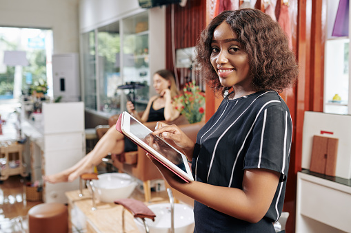 Salon owner checking online booking application