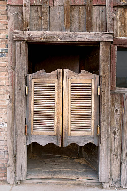 Saloon Doors Old western saloon doors. saloon stock pictures, royalty-free photos & images