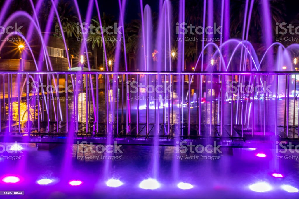 Salou´s fountain tourist show on a cloudy night stock photo