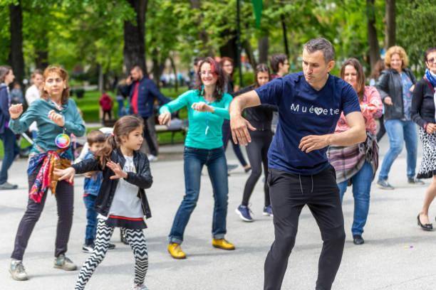 Salsa dance lesson in a park stock photo