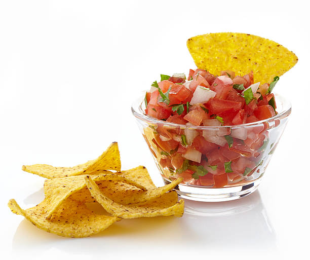 Salsa dip Bowl of salsa dip and nachos isolated on white background salsa sauce stock pictures, royalty-free photos & images