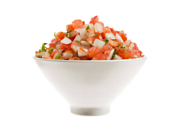 Salsa Fresca In A Bowl Isolated Freshly made salsa fresca (pico de gallo) in a bowl isoalaed on white salsa sauce stock pictures, royalty-free photos & images