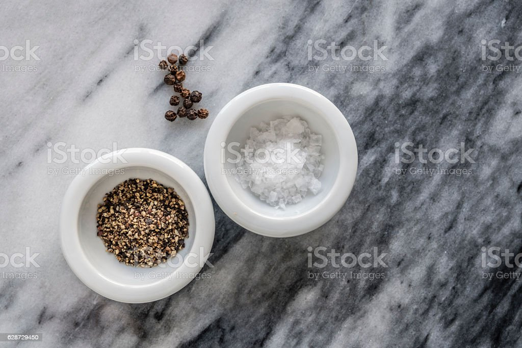 Salt and pepper on marble stock photo