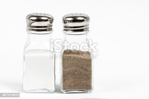 Salt and pepper shaker on white background.