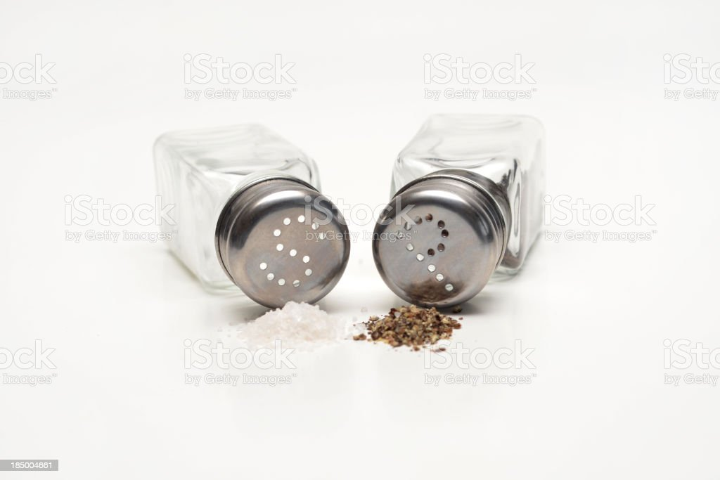 Salt and pepper shakers toppled over stock photo