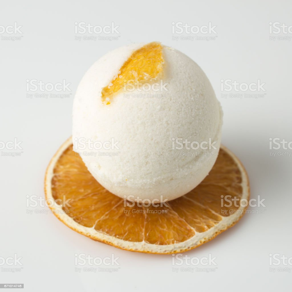 salt bath bomb decorated orange stock photo