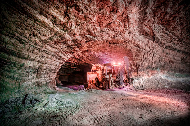 Salt cave and a loader vehicle working Salt cave and a loader vehicle working mining natural resources stock pictures, royalty-free photos & images