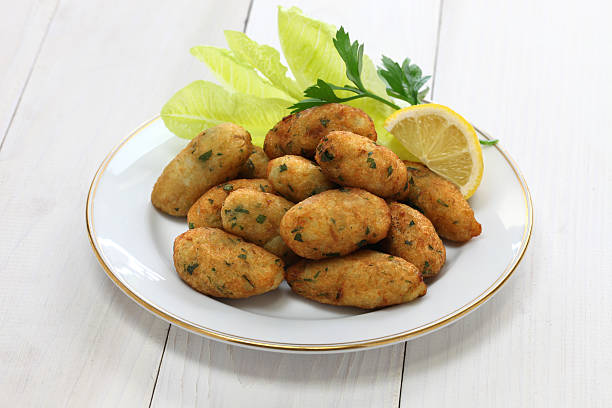 Salt cod fritters and croquettes bolinhos de bacalhau,pasteis de bacalhau,bunuelos de bacalao fritter stock pictures, royalty-free photos & images