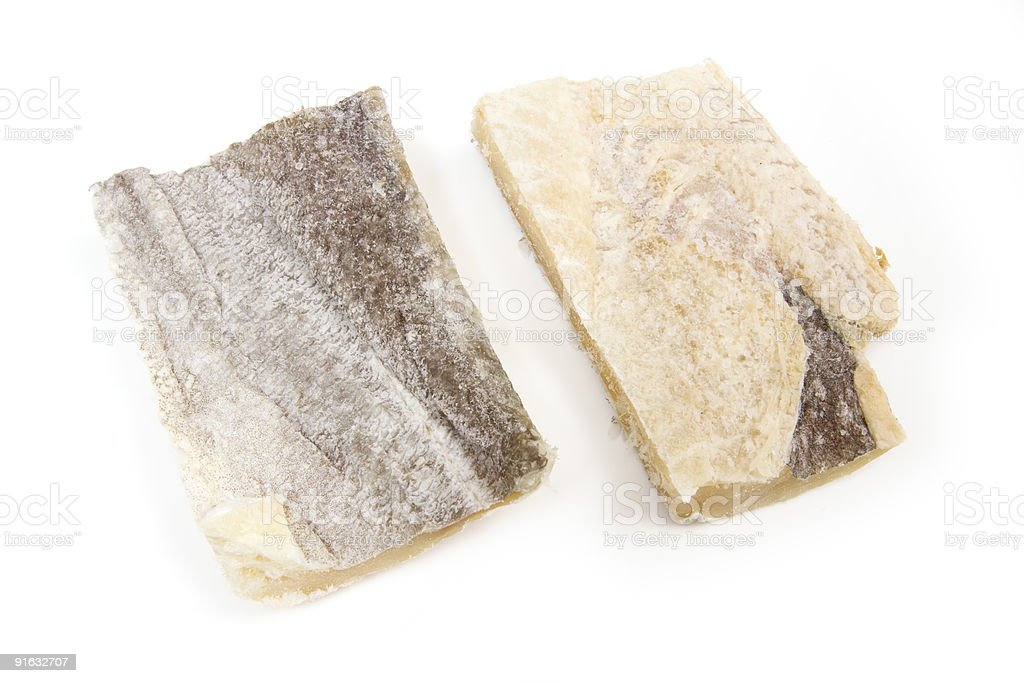 Salt cod on a white studio background. royalty-free stock photo