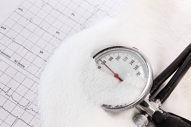 Salt consuming can increase blood pressure, pile of salt stock photo