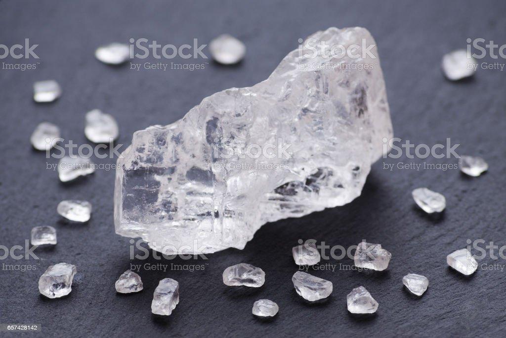 salt crystals over black background, selective focus stock photo