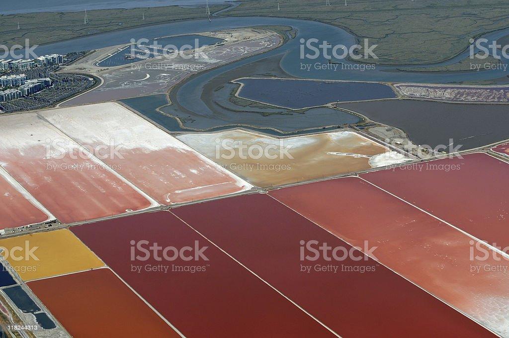 salt evaporation ponds aerial view stock photo