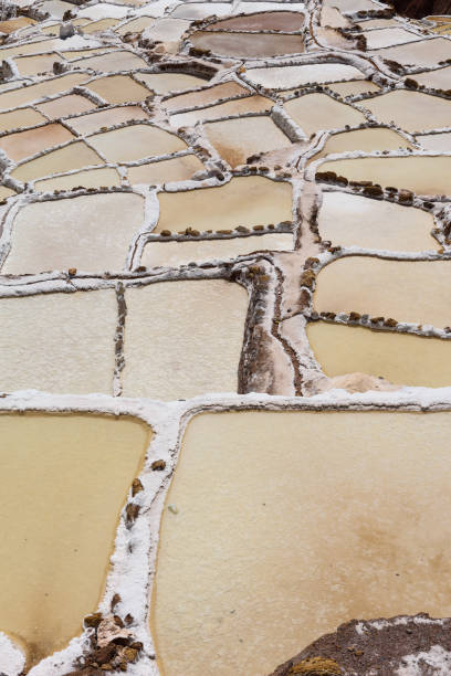 Salt evaporation ponds in the town of Maras in the Sacred Valley near Cusco stock photo