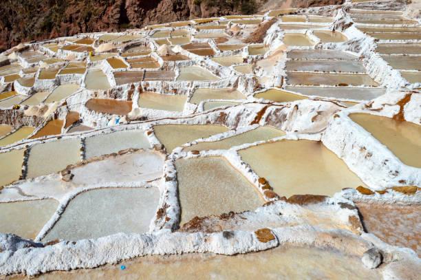 Salt farm pools in Peru stock photo